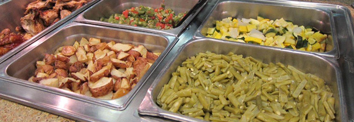 vegetables in trays on a buffet line