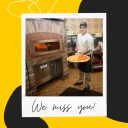 Photo of Campus Dining team member pulling a pizza out of the oven with caption