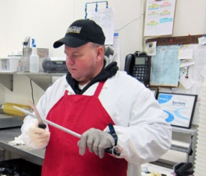 John Baumgardner sharpens knife